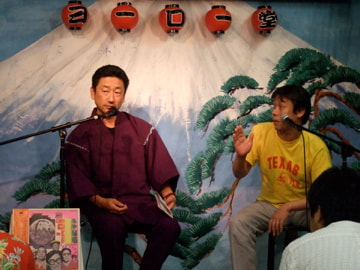 Hayashi Kojiro and Takada Yosuke discuss an old recording at the microphones.
